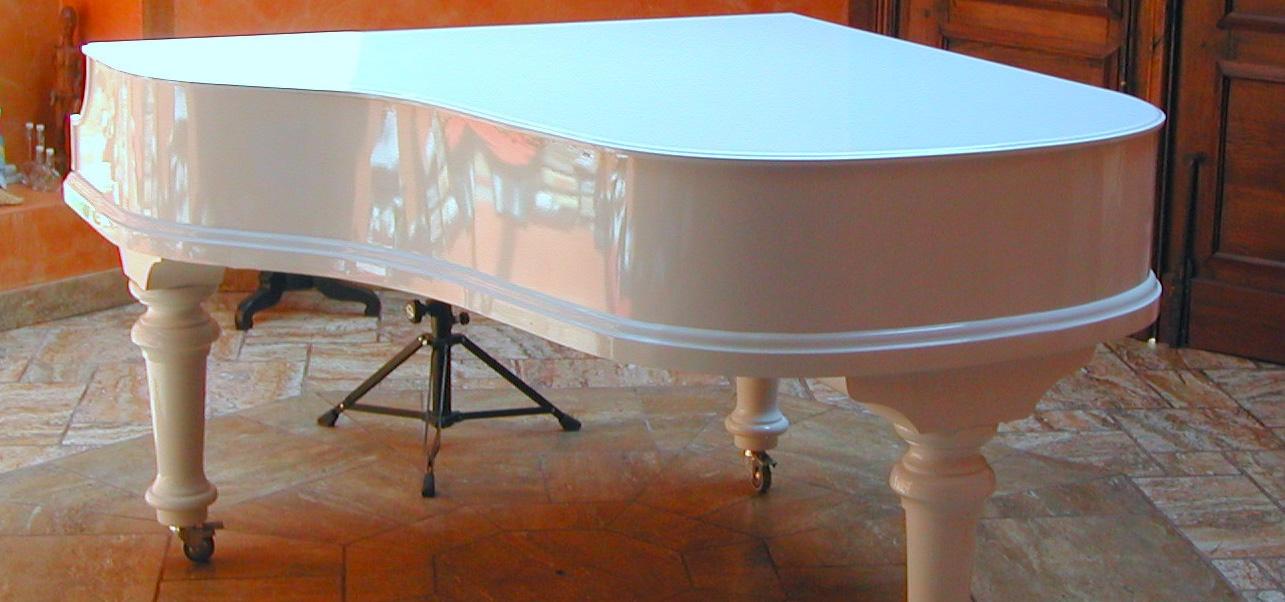 white-grand-piano